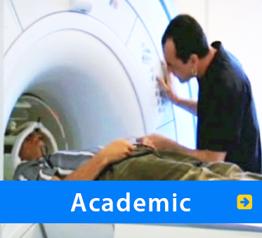 Academic. Image: WAFTB President Daniel Kish enters an MRI machine at a German University.