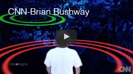 Video Thumbnail from CNN's Vital Signs with Dr. Sanjay Gupta shows an image of World Access For The Blind Perceptual Navigation Instructor Brian Bushway from behind with an outgoing red-colored flash Sonar wave and a green colored echo wave in the episode 'Seeing with Sound'. Click the thumbnail to see and hear the video at CNN.