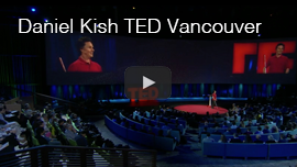 Video thumbnail shows a wide shot of the TED2015 global conference in Vancouver with the audience in the foreground and Daniel Kish onstage flanked by two large screens in the background. Click the thumbnail to go to the video at TED.