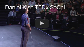 YouTube video thumbnail shows World Access For The Blind President Daniel Kish on stage in front of the audience in the background at the 2011 TEDx SOCal event in Long Beach, California. Click the thumbnail to watch the video on YouTube.