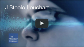 "Video thumbnail shows a closeup from the left side of World Access For The Blind Perceptual Navigation Instructor J Steele-Louchart wearing sunglasses and a woolen cap with an image of a light blue sound wave superimposed over the image. Click on the thumbnail to see and hear and excerpt from ""Freaks of Nature"" which was broadcast on the Weather Channel."