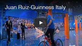 Video thumbnail shows a screen grab of World Access For The Blind Perceptual Navigation Instructor Juan Ruiz at the completion of his bicycle slalom in a TV studio in Italy as he sets his first Guinness World Record. Click the thumbnail to go to the video.
