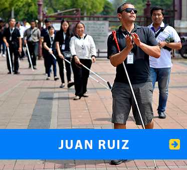 Juan Ruiz. Photo shows Juan leading a group of blind FlashSonar Coach trainees in Bangkok, Thailand. Link to his page.