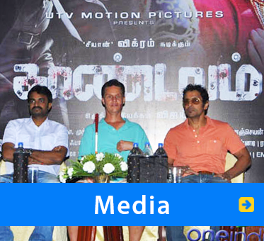 Media. Image: World Access For The Blind President Daniel Kish sits between the director, and Vikram, the star of the Tamil film Vhaandavam on which Daniel consulted.
