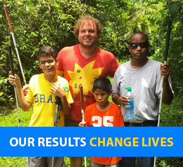 Our Results Change Lives. World Access For The Blind Perceptual Navigation Instructor Brian Bushway stands with three students in Belize.