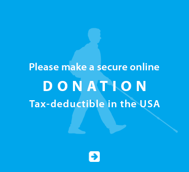 Link box shows a light blue silhouette of Daniel Kish walking with a full-length cane against a deeper blue background. Text reads: Please make a secure online donation. Tax deductible in the USA. Click here to make a donation.