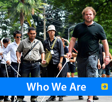 Who We Are. Image: WAFTB Perceptual Navigation Instructor Brian Bushway leads a group of blind students in Bangkok, Thailand.