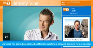 Banner shows the web page of BBC Radio 2 and a photo of host Jeremy Vine next to a smaller photo of Daniel Kish and text that reads On Jeremy Vine: Daniel Kish. The banner text line reads: Our work has gained global media attention creating a growing demand for our services.