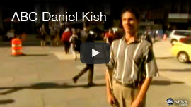 Video thumbnail shows World Access for the Blind president Daniel Kish standing at a street corner with people walking in the background. Click here to go to the video at ABC News.