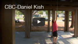 Video thumbnail shows World Access For The Blind President Daniel Kish raising his navigation cane up to touch the roof beams of a sheltered picnic area in a park. Click here to see and hear an excerpt from Canada's CBC Network and it's program 'The Nature of Things'.