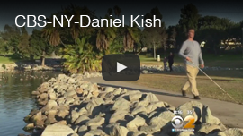 Video thumbnail shows World Access For The Blind President Daniel Kish walking next to a pond in a park in Long Beach, California. Click here to see and hear the video report by CBS New York.