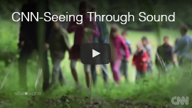 Video thumbnail shows World Access For The Blind President Daniel Kish walking with a group of blind children near a forest in Germany. Click here to see and hear the CNN Vital Signs program 'Seeing with Sound'.