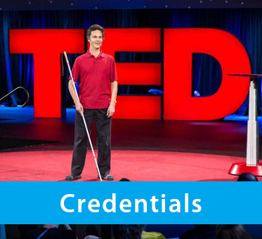 Photo shows Daniel Kish on stage at TED2015 in Vancouver with the large TED logo letters as tall as he is in the background. The text band reads: Credentials.