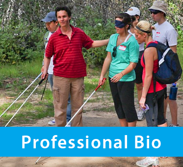Photo shows Daniel Kish working with blind and low-vision students along a trail in the woods. The text band reads: Professional Bio.