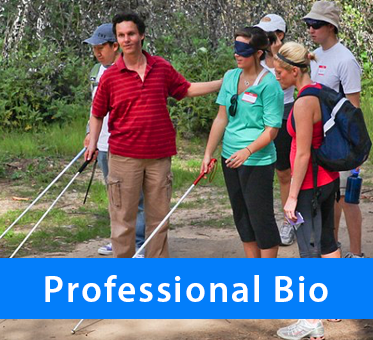 Professional Bio. Photo: Daniel Kish provides cane training to blind and blindfolded sighted students.