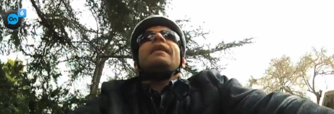 Wide banner photo shows World Access For The Blind Perceptual Navigation Instructor Juan Ruiz cycling, shot from a GoPro camera mounted on the handlebars.