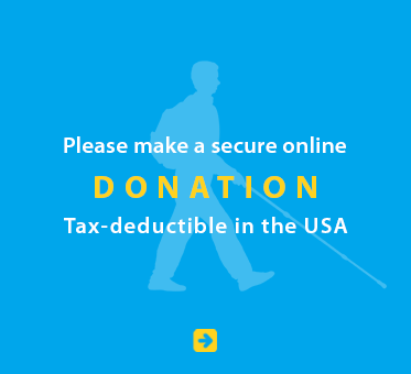 Text box shows a light blue silhouette of Daniel Kish walking with a full-length cane against a deeper blue background. Text reads: Please make a secure online donation. Tax deductible in the USA. Click on the box to go to our donation page.