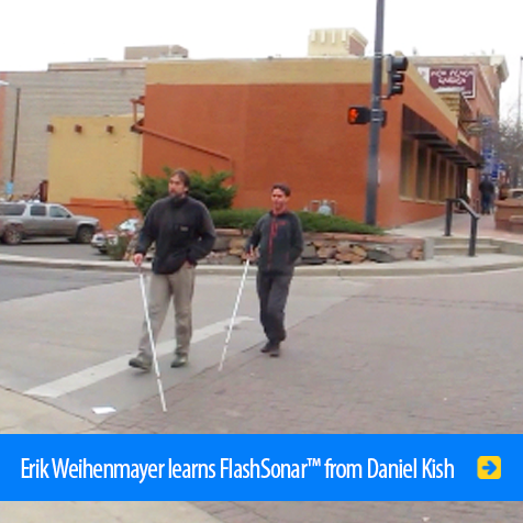 Erik Weihenmayer learns FlashSOnar™ from Daniel Kish. Photo shows them training and crossing an intersection in Colorado.