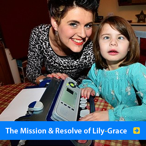 The Mission and Resolve of Lily-Grace. Image shows 8 year-old Lily-Grace Hooper beside her mum Kristy at her Smart Brailler computer.