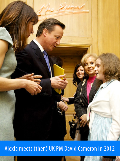 Alexia meets (then) UK Prime Minister David Cameron in 2012. Image. Alexia, along with her mother Isabelle, chats with British Prime Minister David Cameron during a reception at number 10 Downing Street in London in 2012.