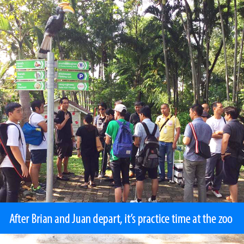 After Brian and Juan depart, it's practice time at the zoo. Image. Student coaches get instructions from Professor ML Taya Kitiyakara at the Dusit Zoo in Bangkok, Thailand.