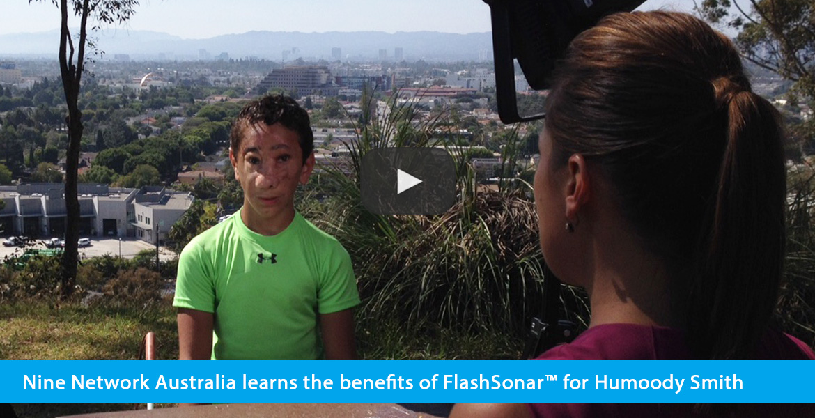 Nine Network Australia learns the benefits of FlashSonar™ for Humoody Smith. Image shows a large video thumbnail of Humoody Smith being interviewed by a reporter at a park with the skyline of Los Angeles in the background.