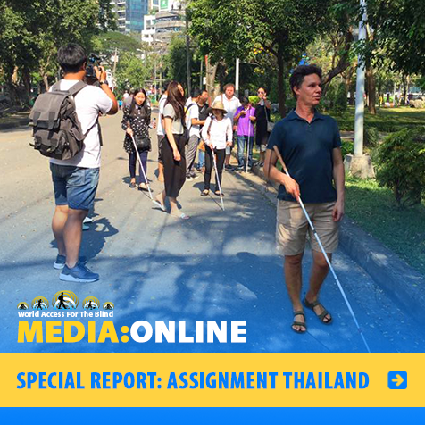 Media:Online. Spe2cial Report: Assignment Thailand. Image: WAFTB President Daniel Kish leads a group of blind student instructors along a road in Bangkok, Thailand.