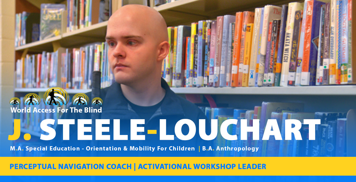 J. Steele-Louchart, Perceptual Navigation Coach, Activational Workshop Leader. M.A. - Special Education - Orientation and Mobility for Children. B.A. Anthropology. Photo: J stands beside bookshelves in a library.