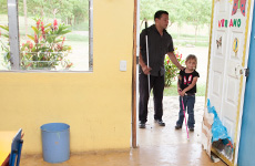 Visioneer Juan Ruiz is pictyred working with a young blind girl on her visiioneering skills at school in Mexico.