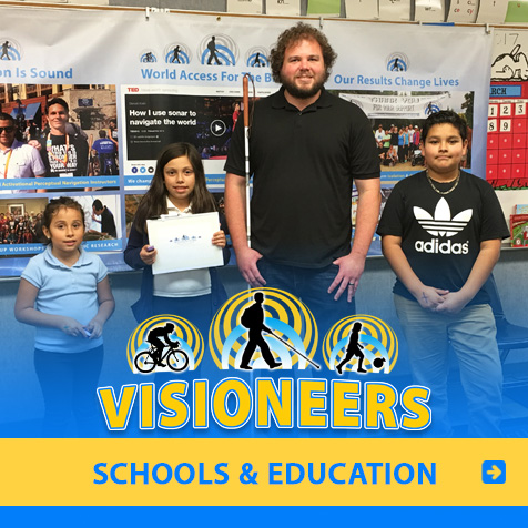 Schools and Education: Photo of Visioneer Brian Bushway standing with children in the classroom of their L.A. area school on Science Day.