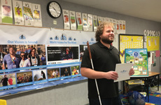 Visioneer Brian Bushway is puctured holding a reflective board as he stands at the front of a classroom in Los Angeles.
