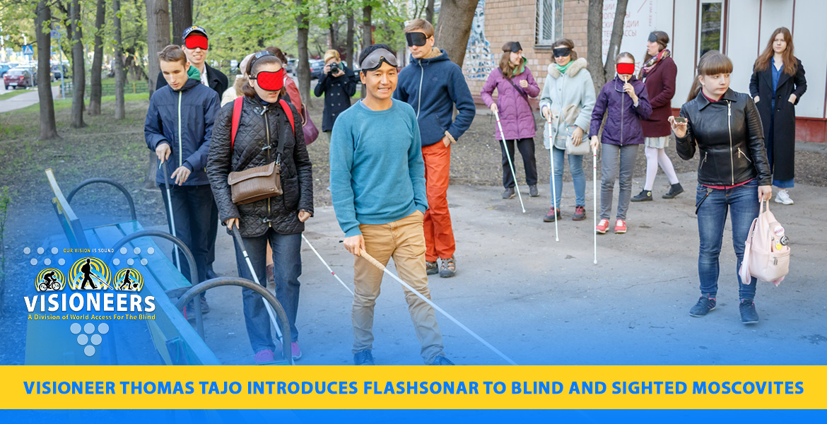 Visioneer Thomas Tajo introduces FlashSonar to blind and sighted Moscovites. Photo shows Thomas leadingblind participants and blindfolded sighted participants outside a theater courtyard in Moscow.